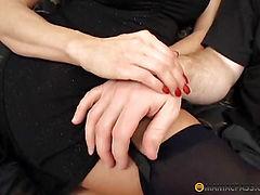 Brunette does blowjob two men