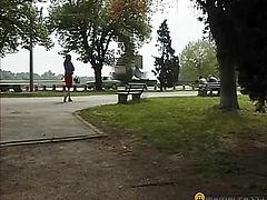 Girl pee sitting under a bush