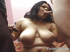 Fat girl takes two cocks all at once