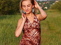 Stream video of horny blonde teen with balloons stripping and spreading legs in the field.