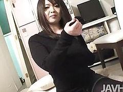 Horny Japanese teen Aika Sawawatari on her knees sucking a long pole