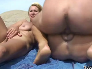 The blonde nude on beach shower