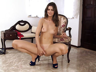 With tiny breasts and trimmed cunt parts her legs to fuck herself, take dildo in her eager vagina