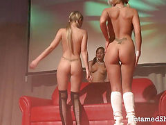 Lovely strippers lick and fuck a giant dildo