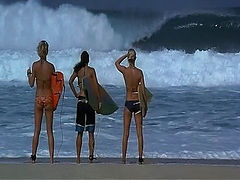 Kate Bosworth and Michelle Rodriguez both look very hot in a bikini while surfing in the ocean. Then we see Kate Bosworth nude showing a bit of her ass and the side of her breast in the shower. From Blue Crush.