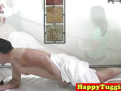 Real thai masseuse rubs cock