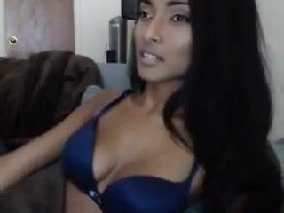 Beautiful dark girl dances on webcam