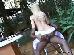 The blonde sat her ass on his cock
