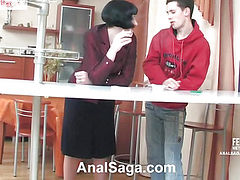 Brunette fucks a smoke with a man