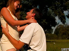 Beautiful girl fucks with a guy on the nature