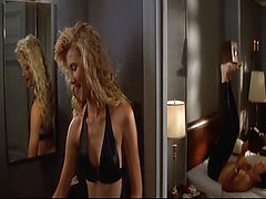 Laura Dern seen riding a guy while they have sex, and then showing us her breasts as she stands in a bathroom and pulls a top on afterwards. From Wild at Heart.