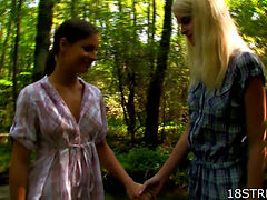 Two girlfriends undressing in the forest