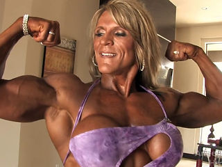 Muscle Milf Flexes Her Muscles