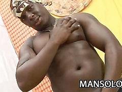 Ebony dude stretching his black cock