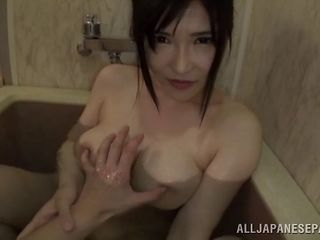 Sucking off a guy in the bathroom after he plays with her pussy