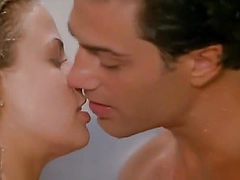 Brooke Burns making love with a guy in a shower, then we see her looking very sexy in famous red swimsuit. From Baywatch.