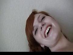 Hot redhead sticks dildo inside her