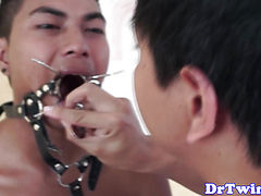 Asian doctor giving enema to patient